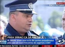 politist cu GUSA si CEAFA PATRATA